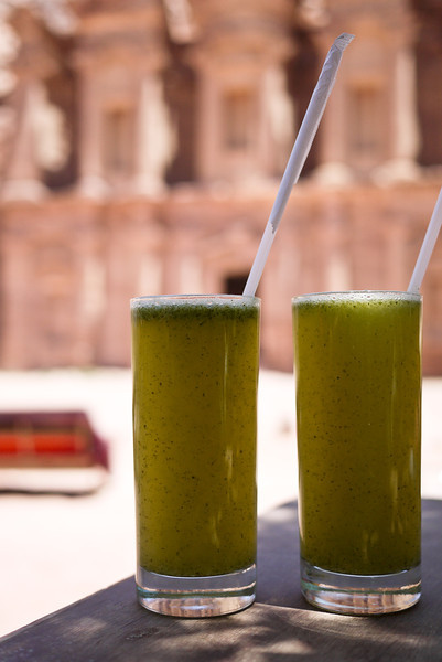 Two lemon-mint drinks set against the pretty Monastery in Petra, Jordan.