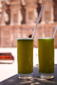 Two lemon-mint drinks set against the pretty Monastery in Petra, Jordan.