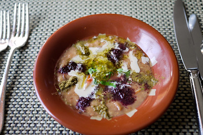 Foul (ful) Mudammas, a local MIddle Eastern dish made from fava beans and topped with spices and seasonings and eaten widely across the region.