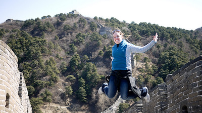 Niki jumping at the Great Wall of China