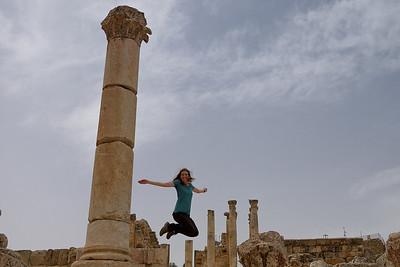 Jumping through the ancient city of Gerasa in Jerash, Jordan.