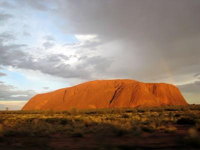 Sun peaking oout on Uluru