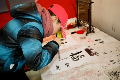 A student shows off her calligraphy skills at the Forbidden City in Beijing, China.