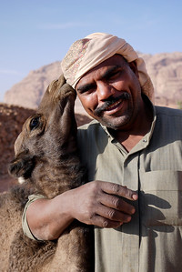 Shabala shows love and care with his camels in Wadi Rum, Jordan