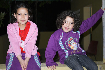 Lovely little girls sweetly smiling for the camera in Rasun, Jordan