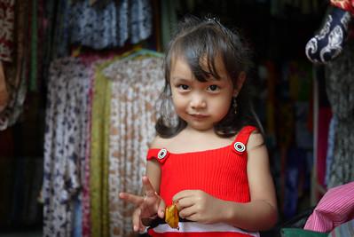 Balinese girl peace sign