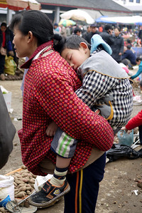 Different carrying methods means little ones get a good sleep; Fuli Market near Yangshuo, China.