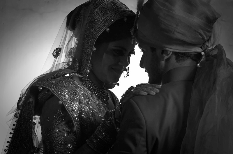 indian bride & groom black and white portrait shot