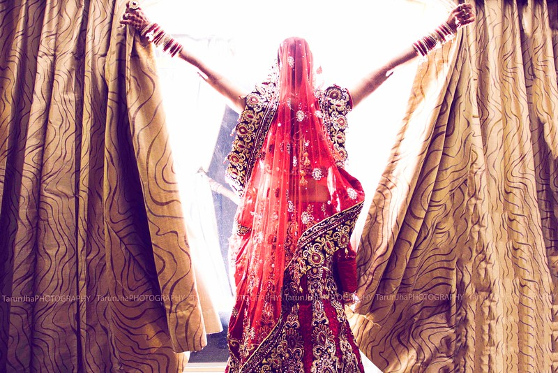 Indian bride opening curtains