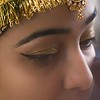 Indian bride getting ready in parlor