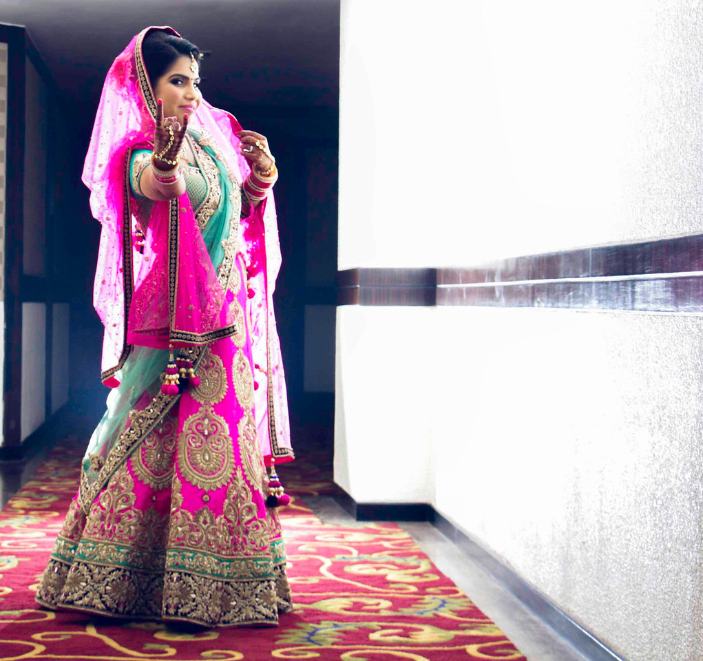 Indian bride posing in front of camera - prebridal photography