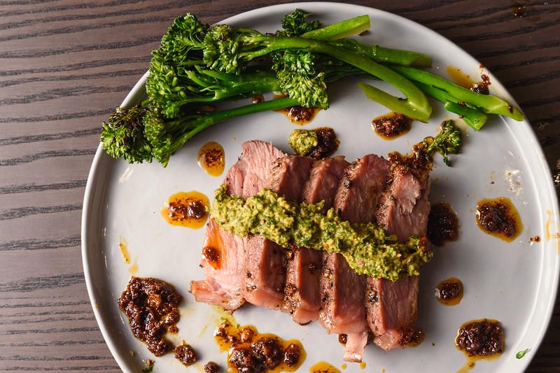 steak with chimmichurri, broccolini, and guajillo chili oil
