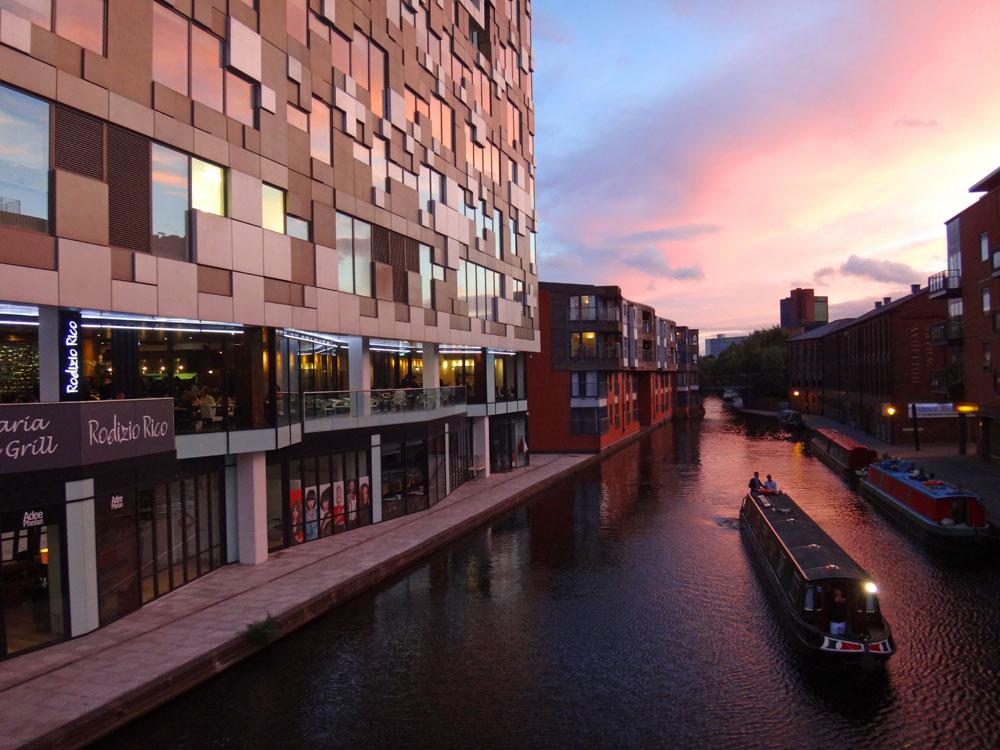 A houseboat near Birmingham's 'Cube' at dusk