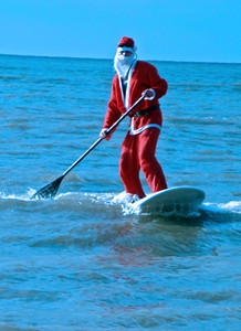 It's a tradition at Brighton, UK, on Boxing Day for the surf-lifesavers to congregate offshore dressed as santas. About 10 of them braved freezing weather in 2009, along with some daring swimmers. Most of the rest of Brighton turned out to watch. Now, who said the English are eccentric?