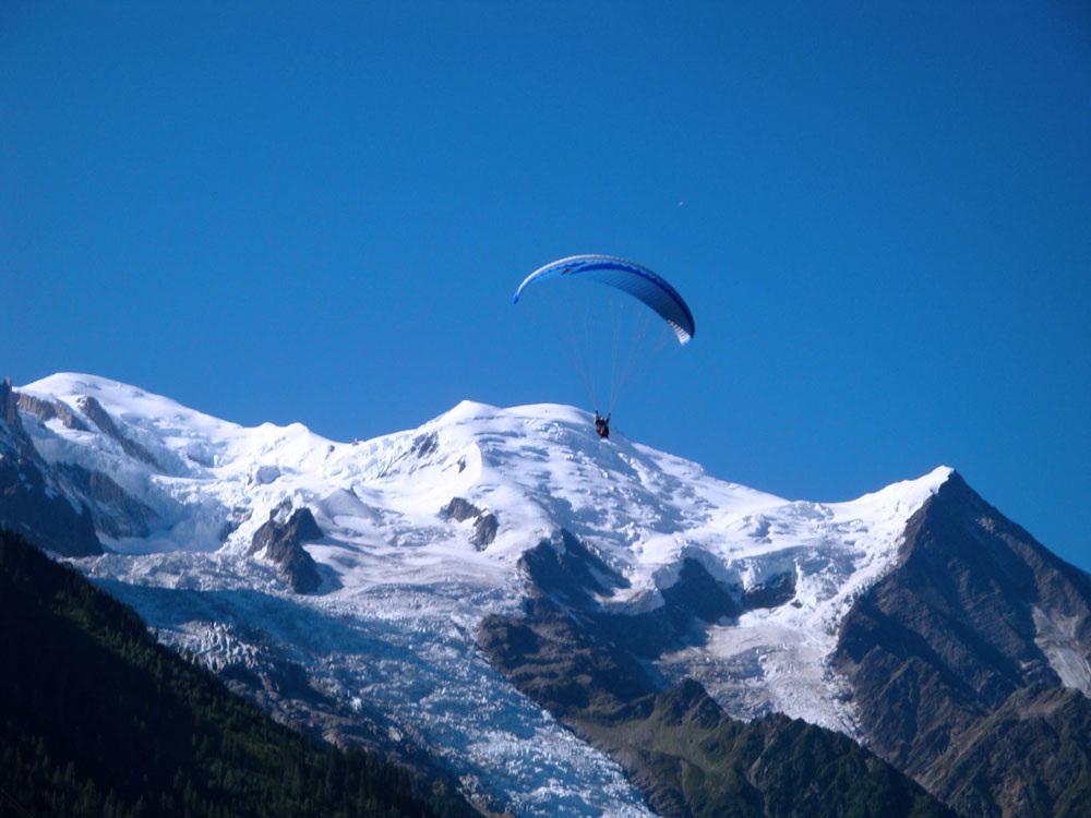 This glider is 'touching' the Dome de Goutier, which is part of the Goutier route to the summit of Mt Blanc visible to the left.