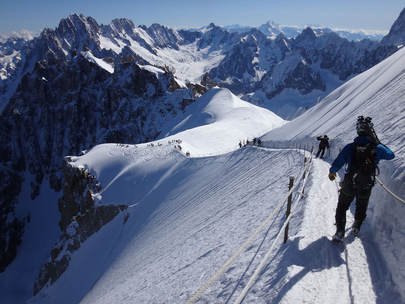 Our 2014 descent of the famous North East ridge of Aiguille du Midi, in the Mt Blanc Massif, French Alps, made most interesting trying to balance skies, without crampons, on ski boots with almost no grip. A 6,000 foot fall awaits any who slip to the left.