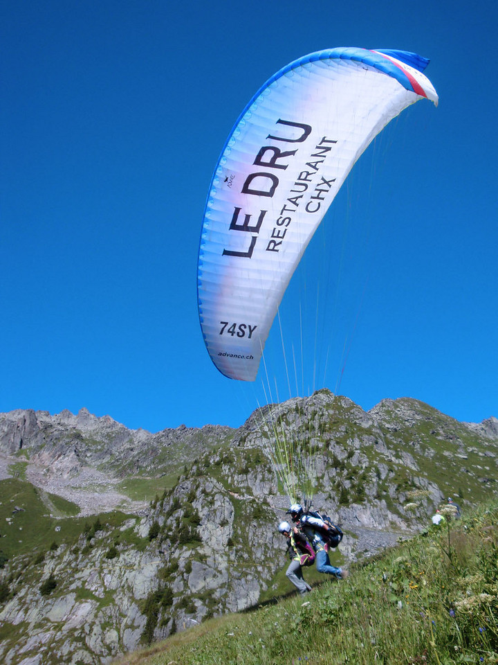 Above Chamonix the Brevent ski area became packed with paragliders taking off in good weather.