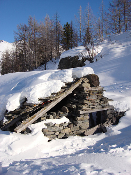 The Italian ski resort of La Thuile connects to the French resort of La Rosiere, allowing skiers to ski across the border several times daily. This ruined stone hut is one of several on the Italian side, abandoned long ago.