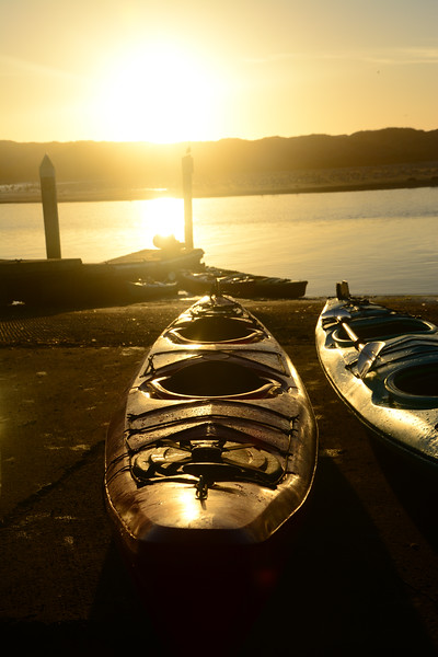 Kayaks at sunset