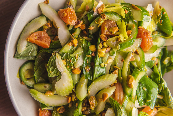 cucumber celery salad with pisatchio, mint, and apricot