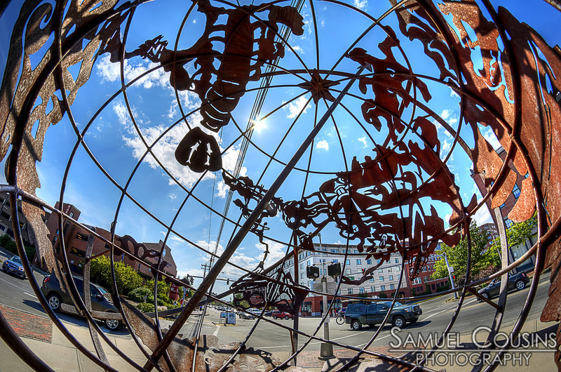 Looking down Commercial St through the metal globe near the Casco Bay Lines