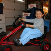 Dio playing with his go kart.