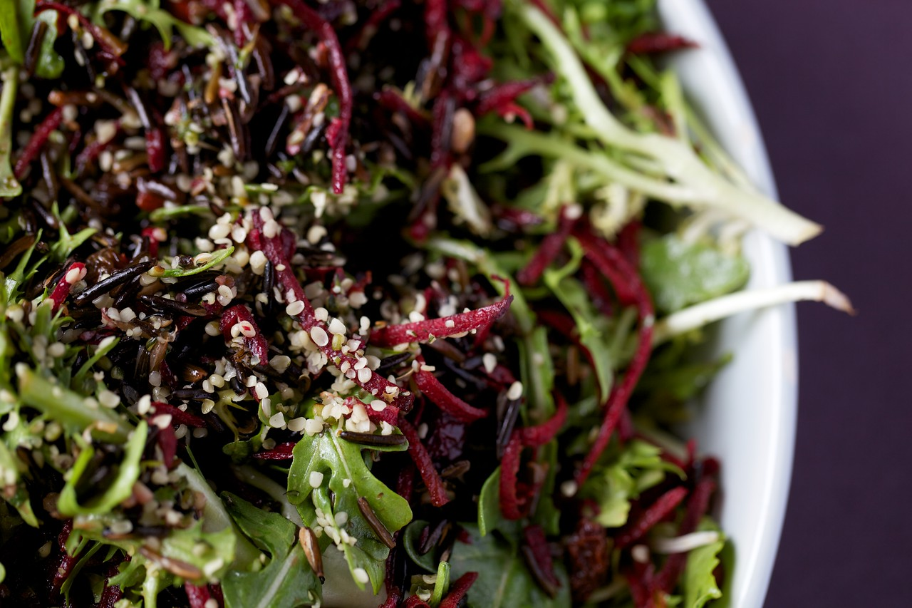 Arugula and frisee salad with wild rice, beets and dried fruit