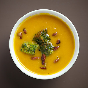 Cumin, coriander and carrot soup with pecans and dill croutons.