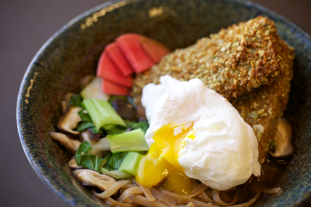 Money shot! Lemongrass broth with hoisin rice noodles, pistachio-crusted tofu, pickled radishes, bok choy, shiitakes, and a poached egg