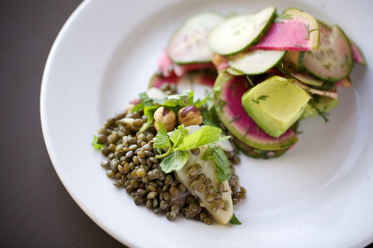 Warm celery root and puy lentil salad with mint and hazelnuts next to cool avocado-dill-cucumber-watermelon radish salad