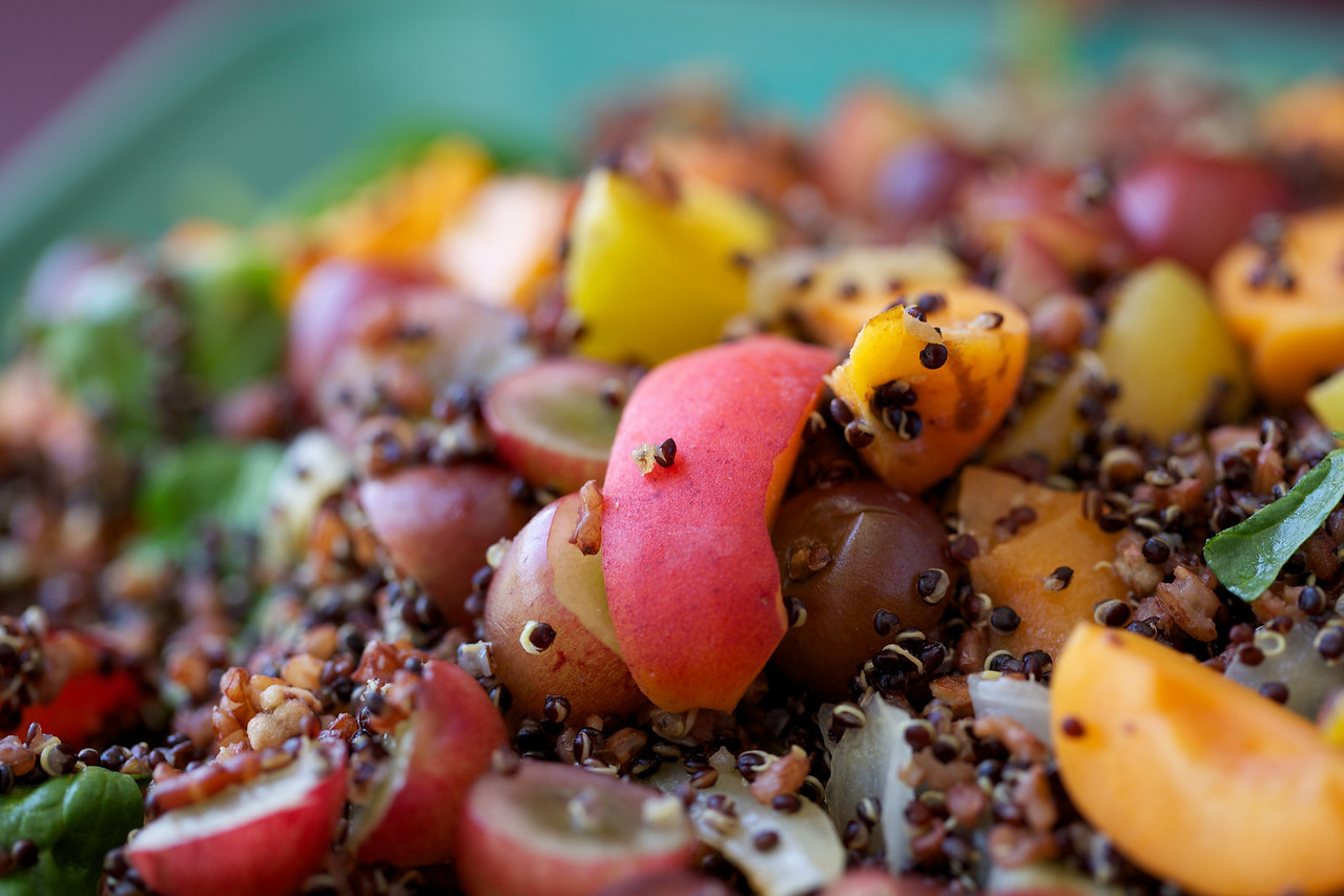 Stone fruit, red rice, black quinoa and spinach salad