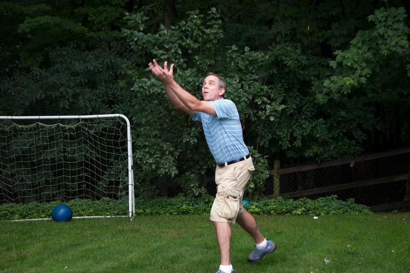 John calls on the baseball skills of his youth.