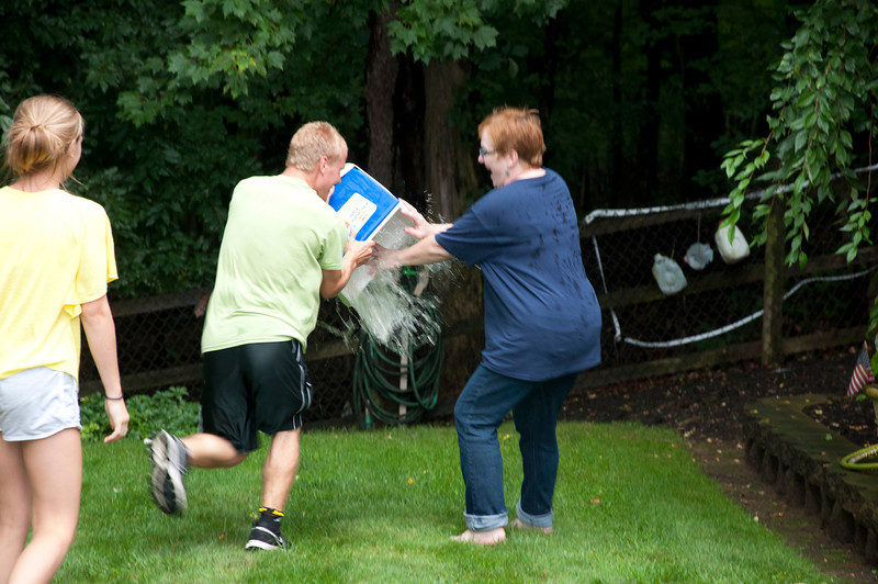 Donna fends off Jimmy's cooler of water.