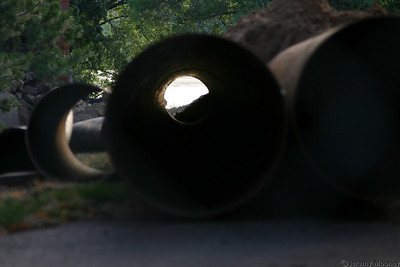 The lake through some of the large metal pipes