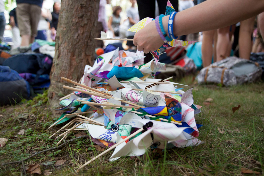". Some attendees of Wednesday\'s ""Betsy Sawyer Day\"" ceremony at the Prescott School made pinwheels bearing messages of peace. Nashoba Valley Voice/Chris Lisinski"