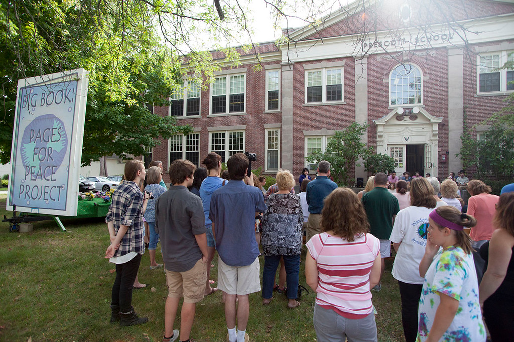 ". Dozens of people gathered outside the Prescott School on Wednesday for a ceremony commemorating Sept. 21 as ""Betsy Sawyer Day.\"" The Big Book of Peace also returned to Groton to coincide with the day\'s events. Nashoba Valley Voice/Chris Lisinski"