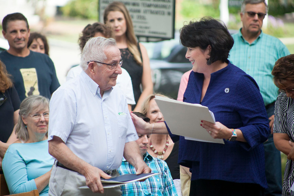 ". State Rep. Sheila Harrington (right) speaks with Charlie Sawyer, widower of storied Groton-Dunstable teacher Betsy Sawyer, at a Wednesday ceremony marking the day as ""Betsy Sawyer Day.\"" Nashoba Valley Voice/Chris Lisinski"