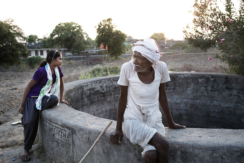 Vaishnavi with his grandfather Marut Rao, 83 near the dried well