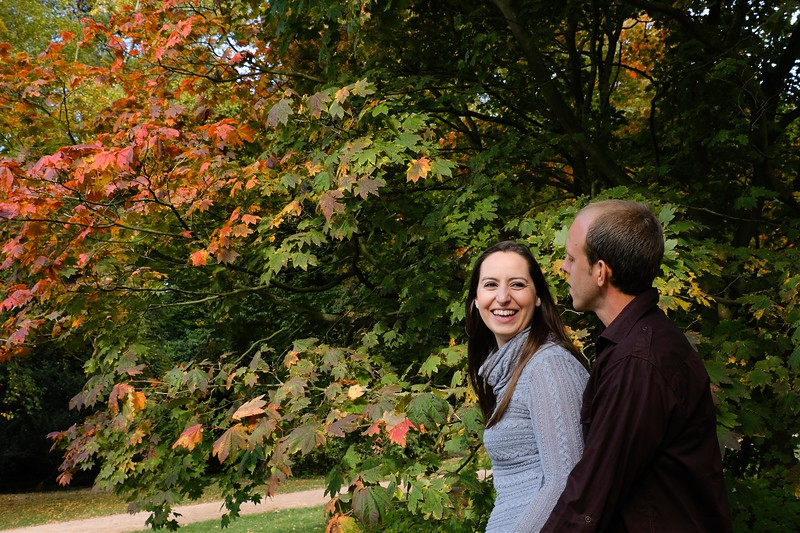 engagement photo shoot lush green and red and yellow autumnal colours