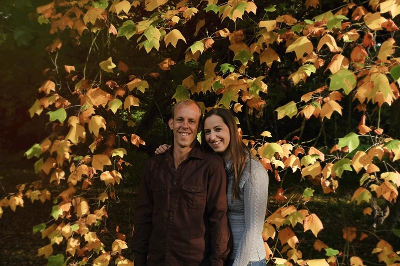 warm autumn colours engagement couple photo