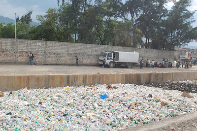 This photo can show what happens when a countrys' citizens aren't provided with a proper way to dispose of trash. This is, in very sense of the phrase, a river of trash.