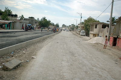 a road that leads out of port-au-prince... it is one of the poorer areas in an already poor country.