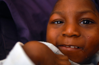 Delome is one of the more mysterious children at Wings. He is partially blind, deaf and mute, and is a seven year old child in the body of a two year old.