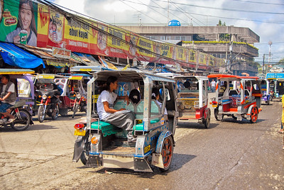 Tricycles in a busy street