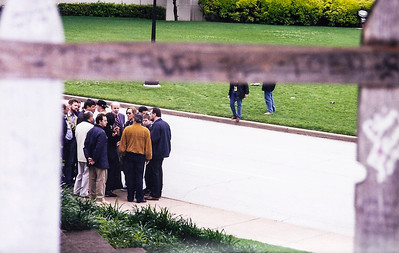 Tourist group at the site of the Kennedy assassination in Dallas, TX