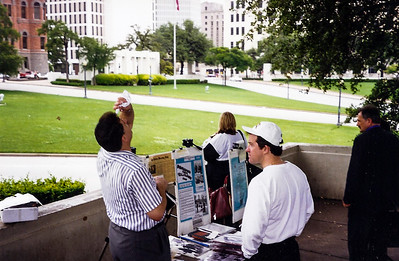 Theorists at the site of the Kennedy assissination in Dallas, TX