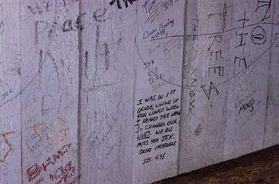 Fencing at the Kennedy assassination site with graffitti