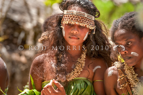 DSC_8146 Traditional dolphin tooth jewellery and headress, decorates a Melanesian woman dancer at a traditional ceremonial wedding dance on Makira. Solomons Group *