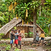 DSC_8065 Village children gather to talk in front of a traditional family dwelling, and beneath a flowering cut nut, or Yum-yum tree (Barringtonia edulis) in Toru Village, Makira, the eastern-most island in the Solomons Group