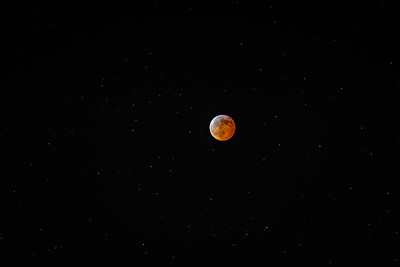 Total lunar eclipse with starfield